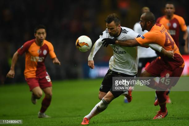 TOPSHOT Benfica's Swiss forward Haris Seferovic fights for the ball with Galatasaray's Brazilian defender Marcao during the UEFA Europa League round...
