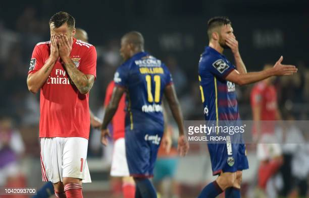 Benfica's Swiss forward Haris Seferovic gestures at the end of the Portuguese league footbal match between GD Chaves and SL Benfica at the Municipal...