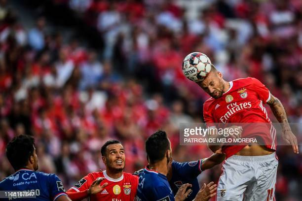 Benfica's Swiss forward Haris Seferovic heads the ball during the Portuguese League football match between SL Benfica and Gil Vicente FC at the Luz...