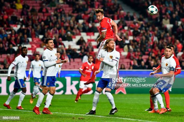 Benfica's Swiss forward Haris Seferovic heads the ball past Basel's defender Michael Lang during the UEFA Champions League football match SL Benfica...