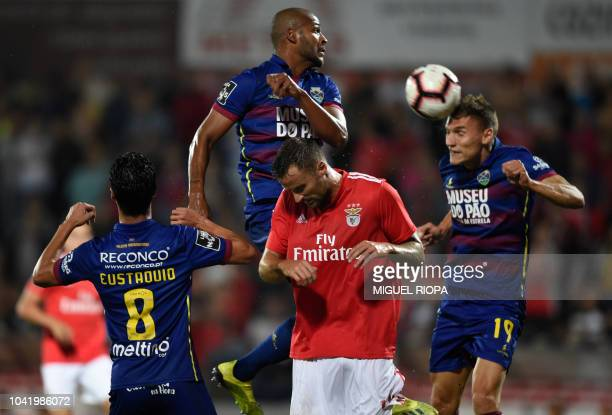 Benfica's Swiss forward Haris Seferovic jumps for the ball with Chaves' Portuguese midfielder Stephen Eustaquio Brazilian defender Marcao and Serbian...