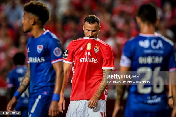 Benfica's Swiss forward Haris Seferovic reacts after missing a goal opportunity during the Portuguese League football match between SL Benfica and...