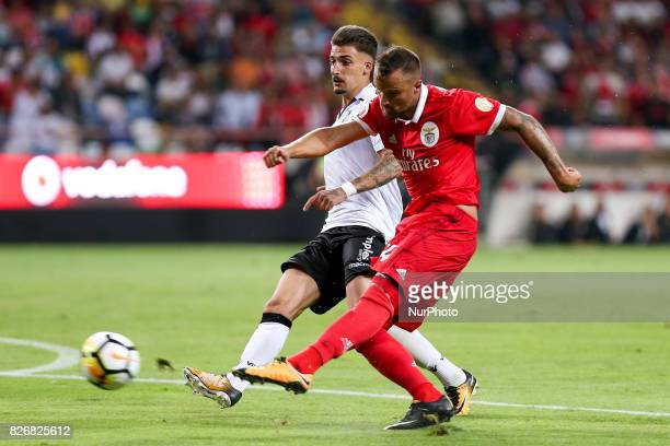 Benfica's Switzerland forward Haris Seferovic in action with Vitoria SC's Portuguese forward Joao Vigario during the Candido Oliveira Super Cup match...