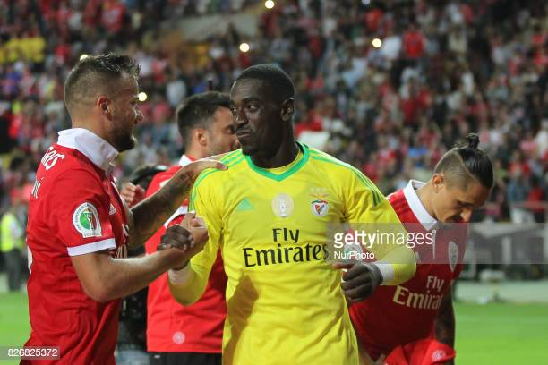 Benfica's Switzerland forward Haris Seferovic with Benfica's Portuguese goalkeeper Bruno Varela celebrates on final match during the Candido Oliveira...