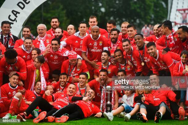 Benfica's team poses for a photo with the trophy at the end of the Portugal's Cup final football match SL Benfica vs Vitoria SC at Jamor stadium in...