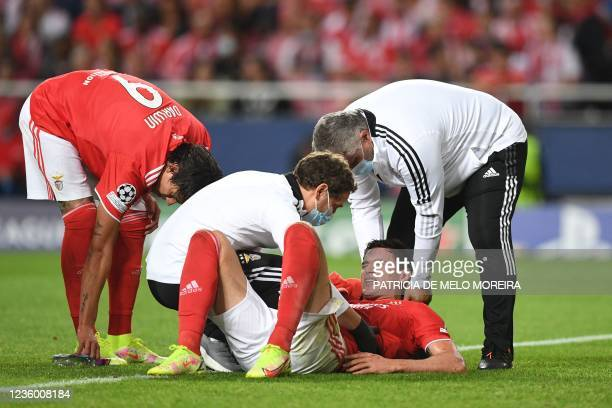 Benfica's Ukrainian forward Roman Yaremchuk receives medical treatment during the UEFA Champions League Group E football match between SL Benfica and...