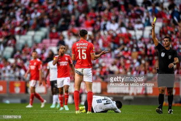 Benfica's Ukranian forward Roman Yaremchuk receives a yellow card from the referee during the Portuguese League football match between SL Benfica and...