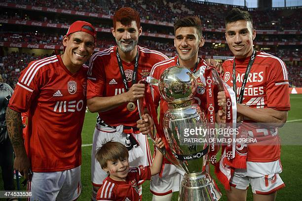 Benfica's Uruguayan defender Maxi Pereira accompanied by his teammates Benfica's Argentine defender Lisandro Ezequiel Lopez Benfica's Argentine...
