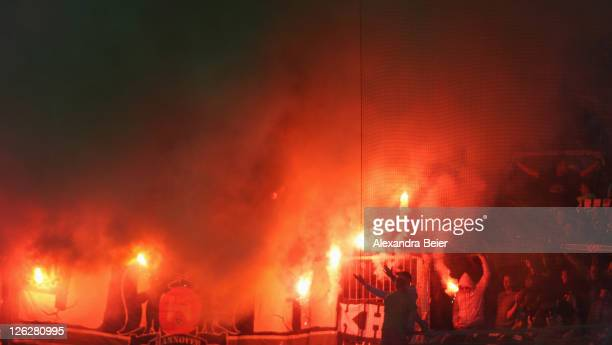 Bengal fireworks burn before the Bundesliga match between FC Augsburg and Hannover 96 at SGL Arena on September 24 2011 in Augsburg Germany