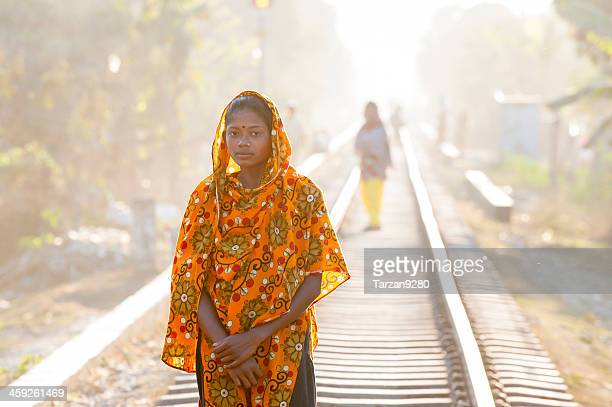 bengali girl standing on the railway - bangladeshi woman stock photos and pictures