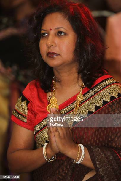 Bengali Hindu woman offering prayers during the Durga Puja festival at a pandal in Mississauga Ontario Canada Hundreds of Bengalis attended the...