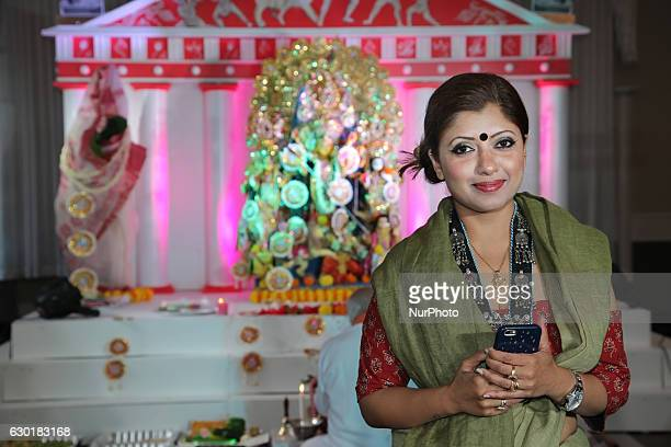 Bengali Hindu woman poses for a photo during the Durga Puja festival at a pandal in Mississauga Ontario Canada on October 15 2016 Hundreds of...