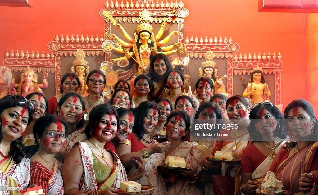 Bengali married women participate in Sindur Khela smearing of the vermilion on Durga Puja's last day Bijoya Dashami at a Durga puja pandal at...