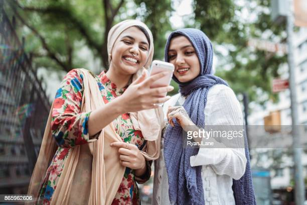 bengali muslim young woman taking selfie - bangladeshi culture stock pictures, royalty-free photos & images