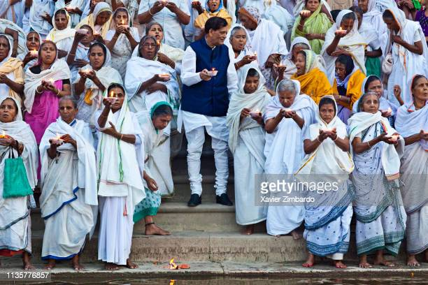 Bengali widows celebrating a fire ceremony at Kesi Ghat in Vrindavan Mathura in Uttar Pradesh on April 16 2014 These aged widows have been abandoned...