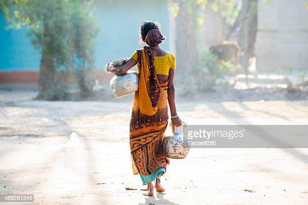 bengali woman carrying water jar in village - bangladeshi woman stock photos and pictures