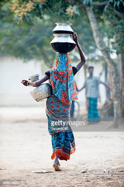 bengali woman heading water jar in village - bangladesh stock photos and pictures