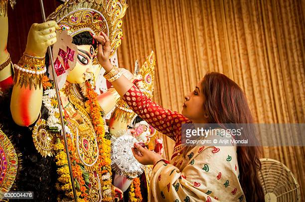 bengali woman hindu devotee offering godess durga - saraswati puja stock pictures, royalty-free photos & images