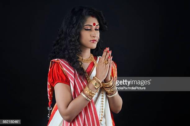Bengali woman praying