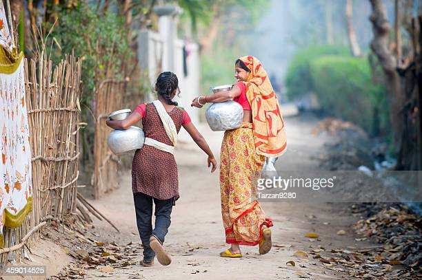 bengali women carrying water jar in village - bangladesh village stock photos and pictures