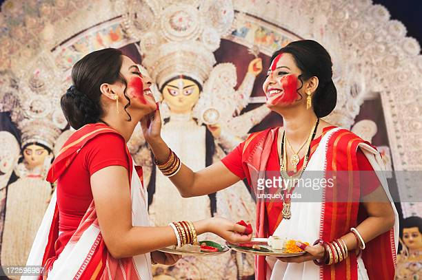 bengali women celebrating durga puja - durga stock photos and pictures