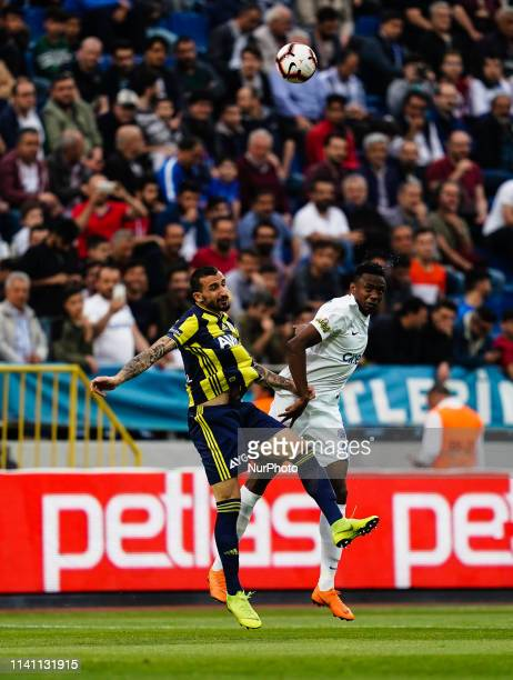 BengaliFodé Koita of Kasimpasa and Mehmet Topal of Fenerbache challenging for the ball during the Turkish Super Lig match between Kasimpasa SK and...