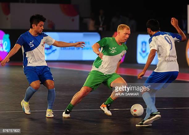 Bengaluru 5's Paul Scholes plays against Goa 5's during their Premier Futsal Football League match in Chennai on July 17 2016 / AFP / ARUN SANKAR
