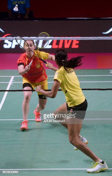 Bengaluru Blasters player Kristy Gilmour of Scotland plays a shot against Chennai Smashers player P V Sinddu of India during their Vodafone Premier...