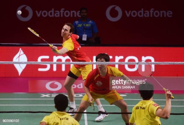 Bengaluru Blasters players Mathias Boe and Kim Sa Rang return the shot to Chennai Smashers players Lee Yang and Sumeeth Reddy during their men's...