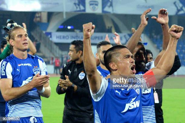 Bengaluru FC captain Sunil Chhetri celebrates with his teammates after victory in the Hero ISL football match between BFC and ATK at The Shree...