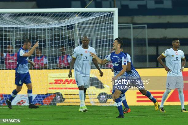 Bengaluru FC player Eduardo Garcia Martin celebrates with his team mates after scoring the first goal of the match against Mumbai City FC during the...