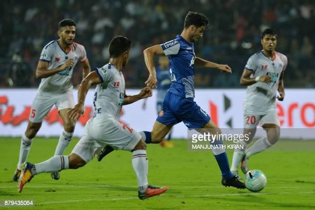 Bengaluru FC player Eduardo Garcia Martin runs the ball during the Indian Super League football match between Bengaluru FC and Delhi Dynamos at the...