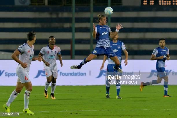 Bengaluru FC player Erik Endel Paartalu heads the ball during the Indian Super League football match between Bengaluru FC and Delhi Dynamos at the...