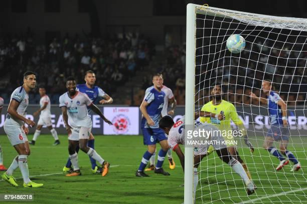 Bengaluru FC player Erik Endel Paartalu scores the second goal against Delhi Dynamos during the Indian Super League football match between Bengaluru...
