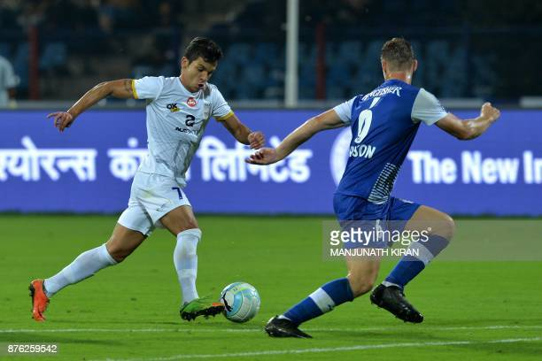 Bengaluru FC player John James Johnson and Mumbai City FC player Everton Leandro Dos Santos Pinto fight for the ball during the Indian Super League...