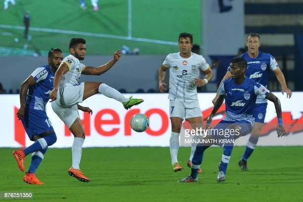 Bengaluru FC player Lenny Rodrigues and Mumbai City FC player Sahil Tavora fight for the ball during their Indian Super League football match at Sree...