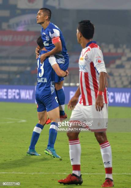 Bengaluru FC player lifts captain Sunil Chhetri after he scored the team's first goal during the Hero ISL football match between BFC and ATK at the...