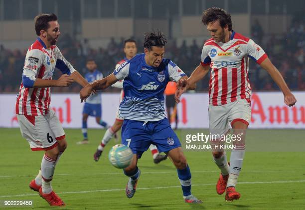 Bengaluru FC player Nicolas Ladislao Fedor vies for the ball with ATK player Jordi Figueras Montel during Hero ISL football match between BFC and ATK...