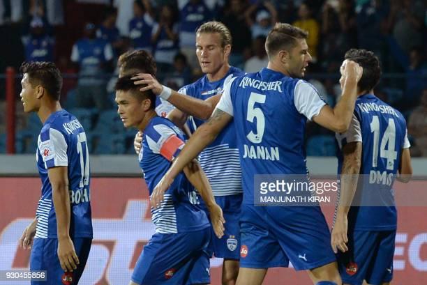 Bengaluru FC players celebrate their first goal scored by captain Sunil Chhetri during the Hero Indian Super League football semifinal second leg...
