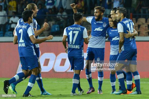 Bengaluru FC players celebrate their first goal scored by their captain Sunil Chhetri during the Hero Indian Super League football semifinal second...