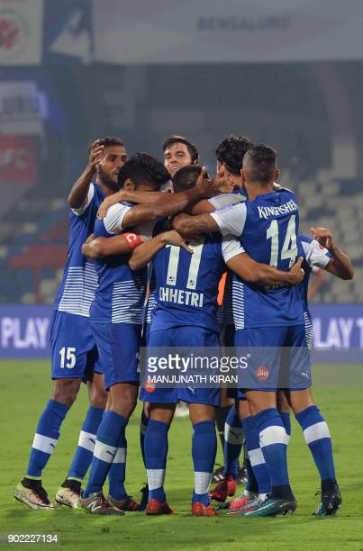 Bengaluru FC players celebrate with captain Sunil Chhetri after he scored the team's first goal during Hero ISL football match between BFC and ATK at...