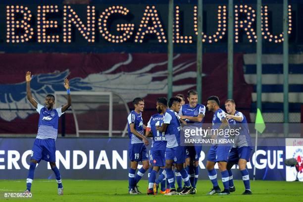 Bengaluru players celebrate their second goal during the Indian Super League football match between Bengaluru FC and Mumbai City FC at Sree...