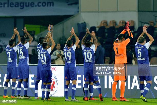 Bengaluru players celebrate with supporters their second goal during the Indian Super League football match between Bengaluru FC and Mumbai City FC...