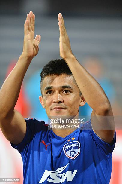 Bengaluru's captain Sunil Chhetri who scored two goals applauds supporters at the end of the 2016 Asian Football Confederation Cup semifinal second...