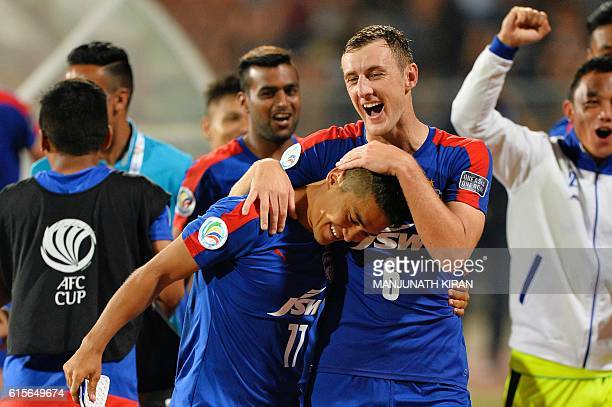 Bengaluru's John Johnson congratulates his team captain Sunil Chhetri on scoring two goals as they celebrate after winning the 2016 Asian Football...