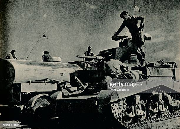 Benghazi ahead; The Army and the Air Force advanced hand in hand; Here a Honey tank, outdistancing its own supply vehicles, draws petrol from an RAF...