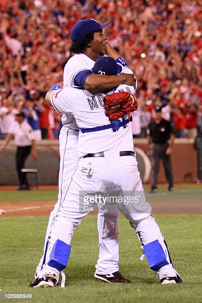 Bengie Molina and Neftali Feliz of the Texas Rangers celebrate after defeating the New York Yankees 61 in Game Six of the ALCS during the 2010 MLB...