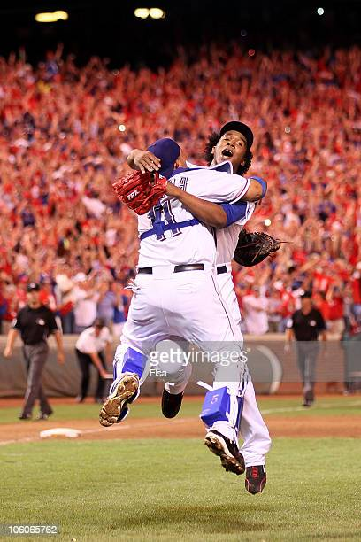 Bengie Molina and Neftali Feliz of the Texas Rangers celebrate after defeating the New York Yankees 61 in Game Six of the ALCS to advance to the...