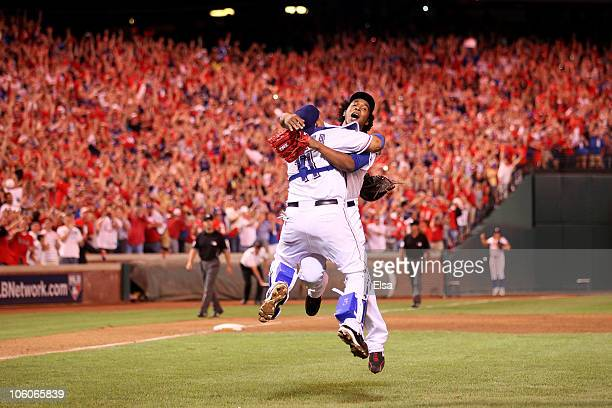 Bengie Molina and Neftali Feliz of the Texas Rangers celebrate after defeating the New York Yankees 6-1 in Game Six of the ALCS to advance to the...