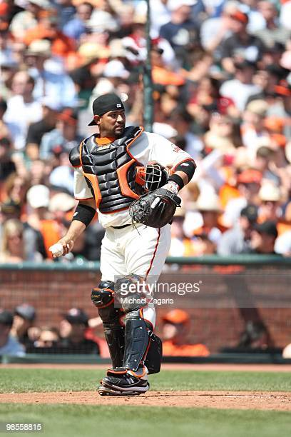 Bengie Molina of the San Francisco Giants catching during the game against the Atlanta Braves on Opening Day at ATT in San Francisco California on...